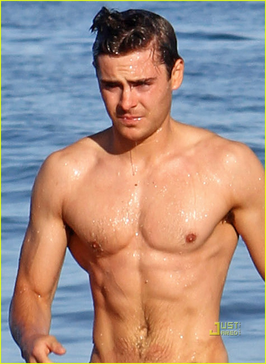 EXCLUSIVE  A Shirtless Zac Efron showed off his six pack abs while    Zac Efron Body 2012